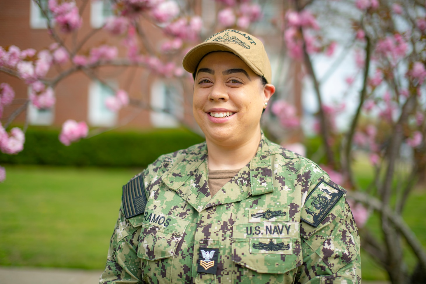 Information Systems Technician 1st Class Corinna Ramos, assigned to Commander, Submarine Force Atlantic (COMSUBLANT), stands outside of COMSUBLANT headquarter in Norfolk, Va., April 15, 2021.