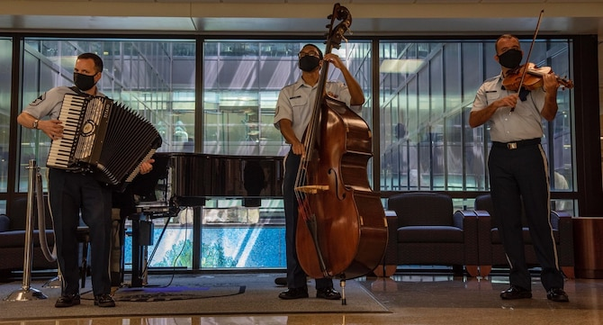 Senior Master Sgt. Frank Busso, accordion, and Technical Sgt. Victor Holmes, bass, make up the heartbeat of the Strolling Strings ensemble. (Photo by Mass Communications Specialist 2nd Class Kurtis A. Hatcher)