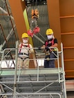 Ship Repair Facility and Japan Regional Maintenance Center's carpenter shop personnel receive one-on-one training on scaffold construction.