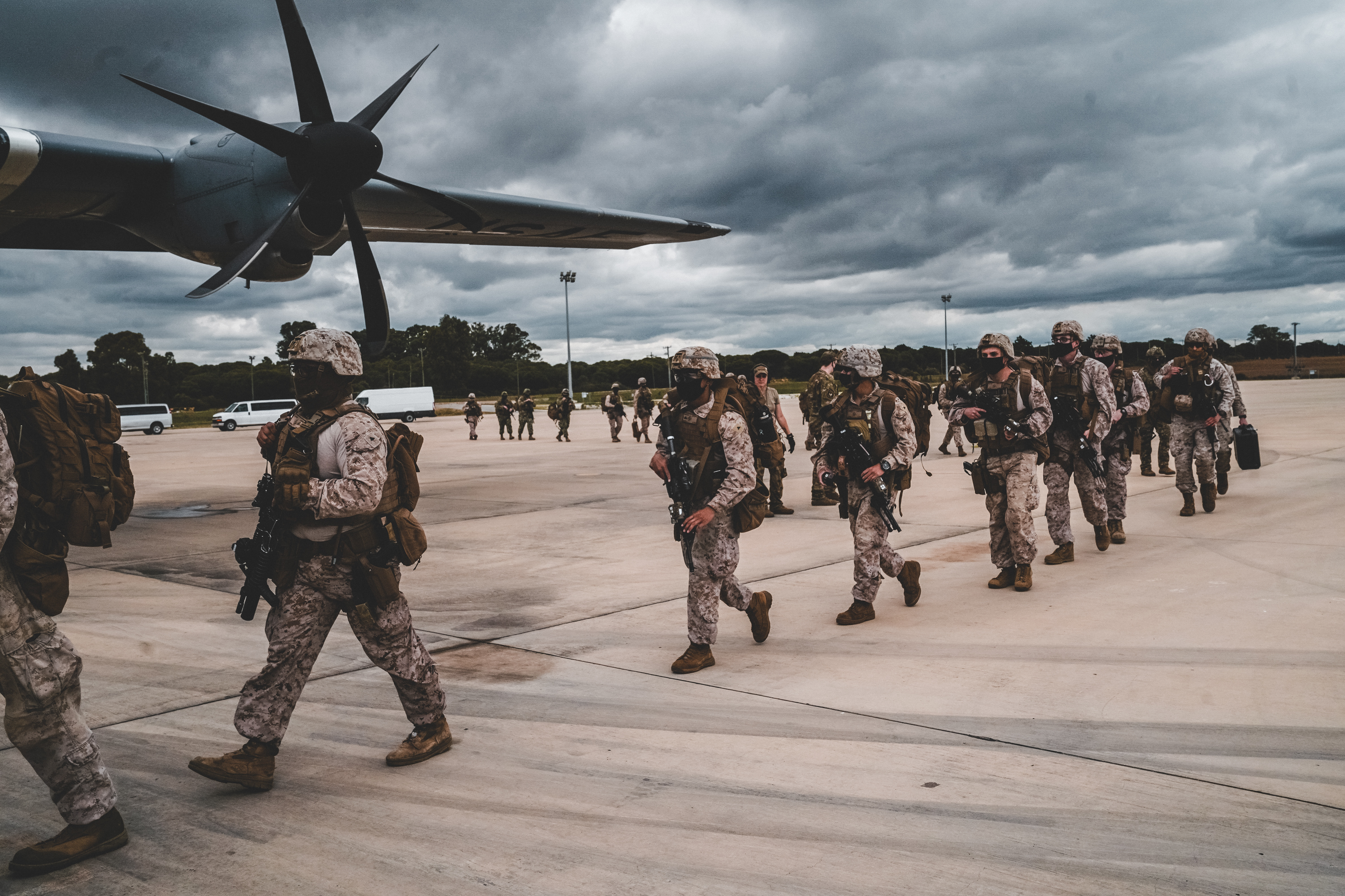 "U.S. Marines with Fleet Anti-terrorism Security Company, Europe (FASTEUR), U.S. Navy Sailors Explosive Ordnance Disposal Mobile Unit 8 (EODMU 8), and Naval Construction Forces, the ""Seabees"", Commander, Task Force - 68 (CTF-68) personnel board a U.S. Air Force C-130 in Rota, Spain for a joint forces readiness exercise in Mali, Africa."