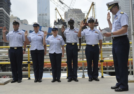 NEW YORK - Coast Guard Petty Officers, from left, Stephen Miller, Heather Clark, Paola Colon, Marc-Antoine Jean and Chief Petty Officer Hugo Gaytan, all of Coast Guard Sector New York, recite the oath of enlistment, as Vice Adm. Robert Parker, Commander of the Coast Guard's Atlantic Area, officiates the ceremony. The re-enlistment took place at the New York World Trade Center ceremonial platform, Thurs., May 26, 2011. The ceremony was part of New York Fleet Week, a week-long event in which mariners from around the world are celebrated in a series of maritime-oriented events. U.S. Coast Guard photo by Petty Officer 1st Class Thomas McKenzie