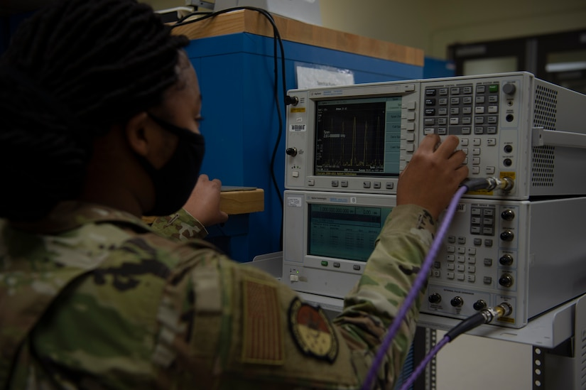 U.S. Air Force Airman 1st Class Ayanna Gaines a test measurement and diagnostic equipment  (TMDE) Apprentice, calibrates a signal generator at Joint Base Charleston, S.C. April 12, 2021. Test measurement and diagnostic equipment is used to accurately measure, calibrate, and test equipment or tools that might need repair.