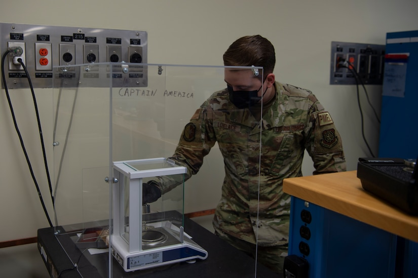 U.S. Air Force Staff Sgt. Chase Lovelace a test measurement and diagnostic equipment (TMDE) technician , calibrates a set of weights on a high accuracy balance scale at Joint Base Charleston, S.C. April 12, 2021. Test measurement and diagnostic equipment is used to accurately measure, calibrate, and test equipment or tools that might need repair.