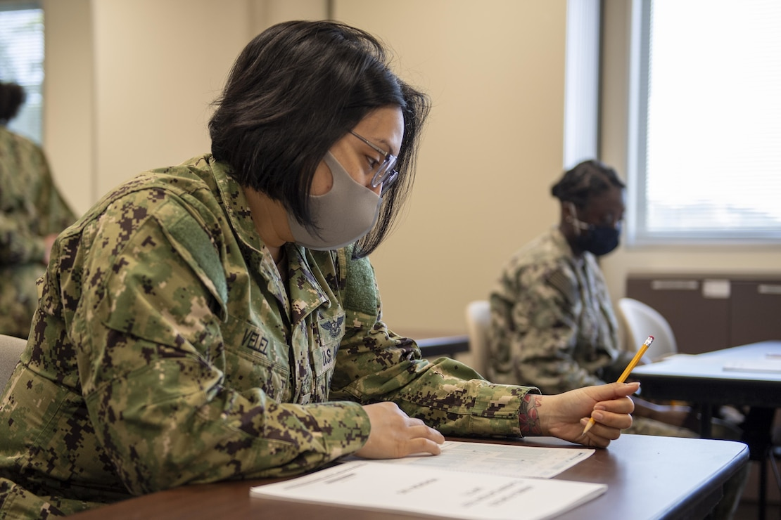 Aviation Boatswain's Mate (Fuel) 3rd Class Latasha Velez, from Tampa, Fla., assigned to the forward-deployed amphibious assault ship USS America (LHA 6), retakes the Armed Services Vocational Aptitude Battery (ASVAB) in the Fleet Activities Sasebo Community Educational Center.