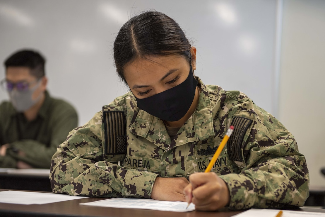 Airman Donna Mae Pareja, from Chalan-Pago, Guam, assigned to the San Antonio-class amphibious transport dock USS New Orleans (LPD 18), retakes the Armed Services Vocational Aptitude Battery (ASVAB) in the Fleet Activities Sasebo Community Educational Center.