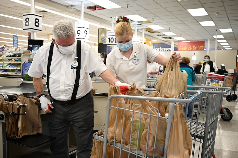 Earnest Aycock (left) and Damaris Lee bag commissary groceries at Hill Air Force Base, Utah, April 8, 2021.