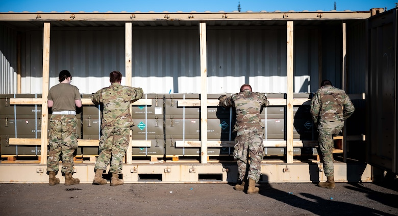 U.S. Airmen from the 354th Maintenance Squadron (MXS) and 354th Logistics Readiness Squadron (LRS) check inventory during a munitions barge at Eielson Air Force Base, Alaska, April 16, 2021.