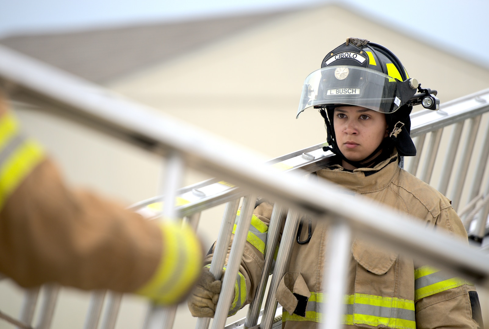Linda Busch-Mendez, Cibolo Fire Department firefighter, holds a ladder during training at Joint Base San Antonio-Randolph, Texas, April 12, 2021.
