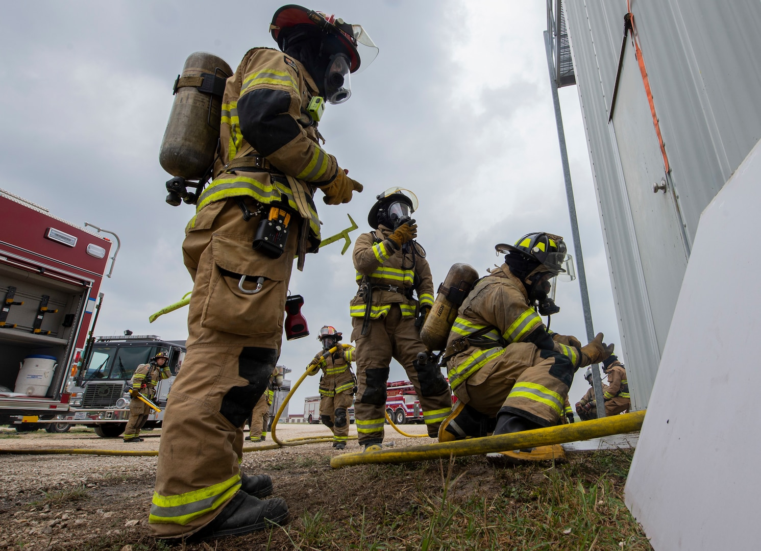 Firefighters from Cibolo Fire Department don gear before responding to a live fire training exercise, April 14, 2021, at Joint Base San Antonio-Randolph, Texas.