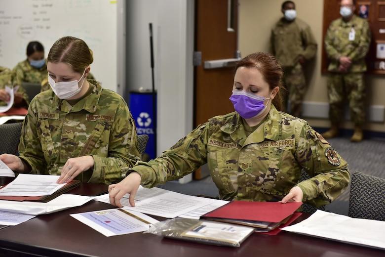 Medics look through pre-deployment paperwork