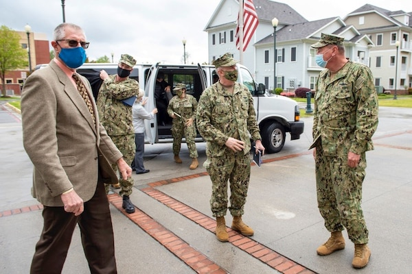 NORFOLK (Apr. 19, 2021) Adm. Bill Lescher, U.S. Navy Vice Chief of Naval Operations, left, is greeted by Adm. Christopher W. Grady, commander, U.S. Fleet Forces Command (USFFC) during a trip to Hampton Roads. USFFC trains, certifies, and provides combat-ready Navy forces to combatant commands that are capable of conducting prompt, sustained naval, joint and combined operations in support of U.S. national interests.