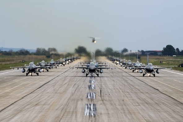 Aircraft from several countries participating in INIOCHOS 21 perform an elephant walk at Andravida Air Base, Greece, April 18, 2021. The 510th Fighter Squadron participated in INIOCHOS 21, a Hellenic air force-led, large force flying exercise. Participation in INIOCHOS 21 allowed U.S. Air Force pilots the opportunity to develop and improve air readiness and interoperability with allied and partner air forces. (U.S. Air Force photo by Airman 1st Class Thomas S. Keisler IV)