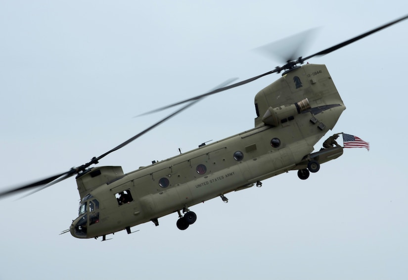A U.S. Army Chinook helicopter flies over Bowman Field during an aerial demonstration for the Thunder Over Louisville air show in Louisville, Ky., April 17, 2021. This year's event featured aircraft from multiple military and civilian agencies. (U.S. Air National Guard photo by Staff Sgt. Clayton Wear)