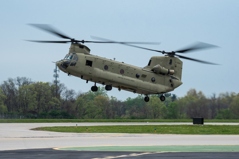 A U.S. Army CH-47 Chinook helicopter performs an aerial demonstration over Bowman Field in Louisville, Ky., April 17, 2021, as part of the Thunder Over Louisville air show. The annual event featured more than 20 military and civilian air craft this year. (U.S. Air National Guard photo by Dale Greer)