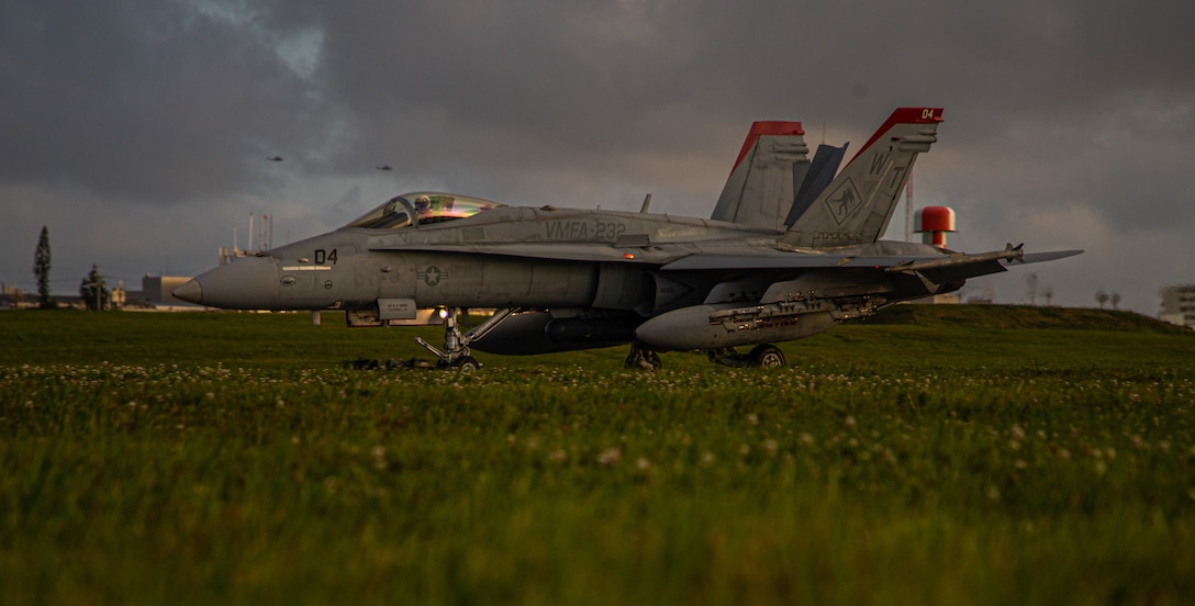 A U.S. Marine Corps F/A-18C Hornet aircraft assigned to Marine Fighter Attack Squadron 323, lands with M-31 arrestment gear during a Marine Corps Combat Readiness Evaluation conducted by Marine Wing Support Squadron 172 on Marine Corps Air Station Futenma, Okinawa, Japan, April 12, 2021.  The MCCRE creates a challenging, realistic training environment that produces combat-ready forces capable of operating as a deployed unit at any time.