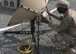 Alabama National Guard Spc. Anthony Hayes, 115th Expeditionary Signal Battalion, April 13, 2021 monitors the signal strength from the Tampa satellite dish that handled communications and data traffic during the Fort Knox, Kentucky, based 1st Theater Sustainment Command's expeditionary command post validation exercise at Camp Arifjan, Kuwait. Hayes, whose battalion is deployed to Camp Buerhing, Kuwait, said he appreciated getting real-world, unscripted training working in the ECP validation exercise. (U.S. Army photo by Staff Sgt. Neil W. McCabe)