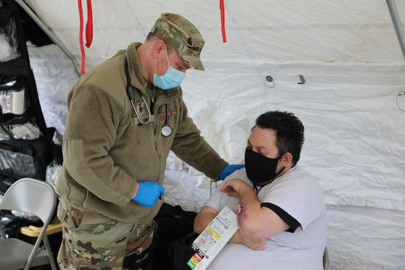 Maj. Robert Holland, a doctor assigned to the New York Aiir National Guard's 105th Medical Group, practices triage and treatment with a civiilain role-player during a Homeland Response Force collective training event in East Amherst, New York on April 17. The 105th Medical Group serves as part of the medical support element of the FEMA Region II HRF, tasked with response in the first hours and days of natural or manmade disasters. (Army National Guard Photo by Capt. Avery Schneider)