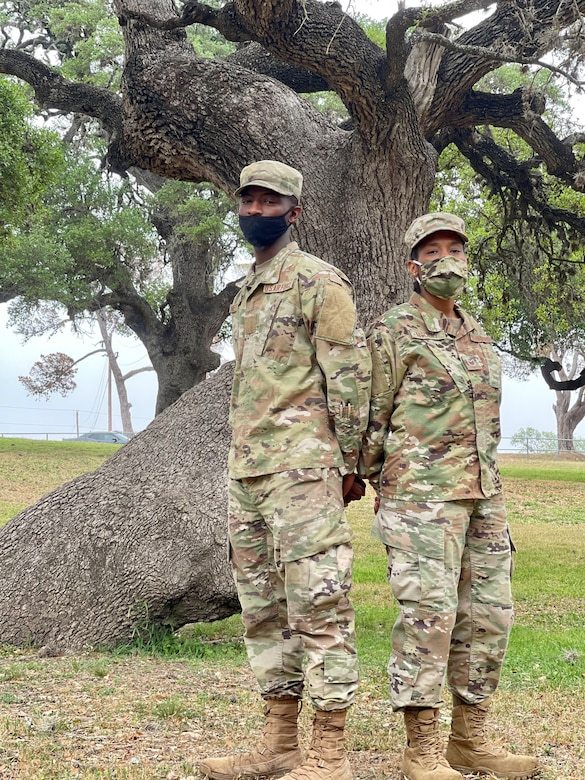 Tech. Sgt. Nessie McCray, 344th Training Squadron, and her son, Airman Basic Jaylen Netterville, 343rd Training Squadron, are shown at Joint Base San Antonio-Lackland, Texas, April 15, 2021. Both look forward to graduating and beginning their new careers. (U.S. Air Force photo by Agnes Koterba)