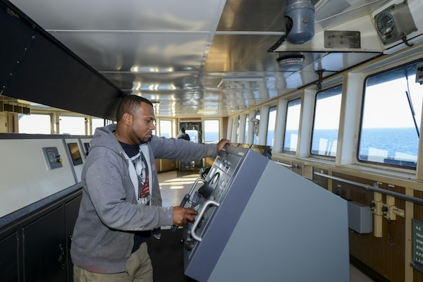 PACIFIC OCEAN (Sept. 30, 2016) A merchant mariner aboard the fast sealift ship SS Capella (T-AKR 293) mans the helm as the ship is underway to conduct a 120-hour turbo activation. The U.S. Transportation Command (TRANSCOM) conducts turbo activation to measure personnel and material readiness of the selected Ready Reserve Force. Capella, more than 40-years-old, is still among the fastest cargo ships in the world and capable of transporting nearly all equipment needed to outfit a full mechanized brigade of the U.S. Army. (U.S. Navy photo by Petty Officer 2nd Class Billy Ho/Released)