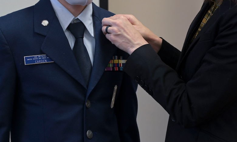 Golden Triangle Composite Squadron Civil Air Patrol cadet 2nd Lt. Matthew Carden, promotes from cadet Chief Master Sgt. to cadet 2nd Lt., during a change of command ceremony, Apr.1, 2021, on Columbus Air Force Base, Miss. Carden took over command of the Golden Triangle Composite Squadron within two years of being a Cadet of the Civil Air Patrol. (U.S. Air Force photo by Airman 1st Class Jessica Haynie)
