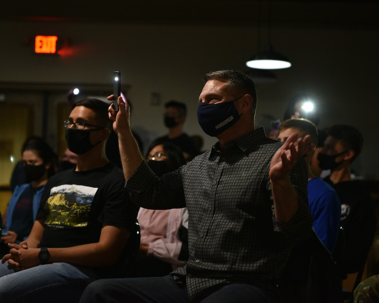 U.S. Air Force Lt. Col. Robert Borger, 17th Training Wing chaplain, holds up a flashlight during the Crossroads talent show on Goodfellow Air Force Base, Texas, April 16, 2021. Borger stated he was amazed by the caliber of talent possessed by many of the Goodfellow students. (U.S. Air Force photo by Senior Airman Ashley Thrash)