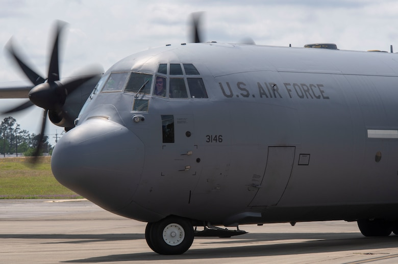 A C-130J taxis on the flightline