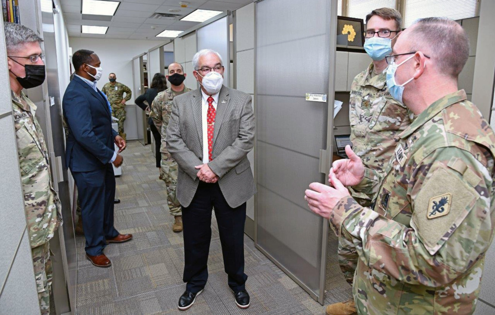 Col. James Jones (far right), Interservice Physician Assistant Program Associate professor, briefs J.M. Harmon III, deputy to the U.S. Army Medical Center of Excellence commanding general, on the renovations and new furniture to their program area.