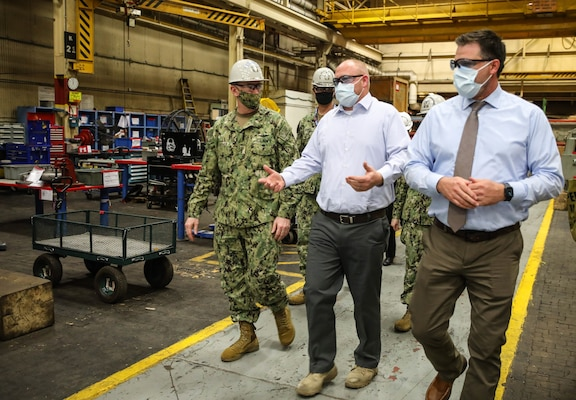 Adm. William Lescher, Vice Chief of Naval Operations, touring Code 930 Inside Machine Shop with Inside Shop Platform Director, Justin Hayden and Group Superintendent, John Rowe, during a visit to Norfolk Naval Shipyard.
