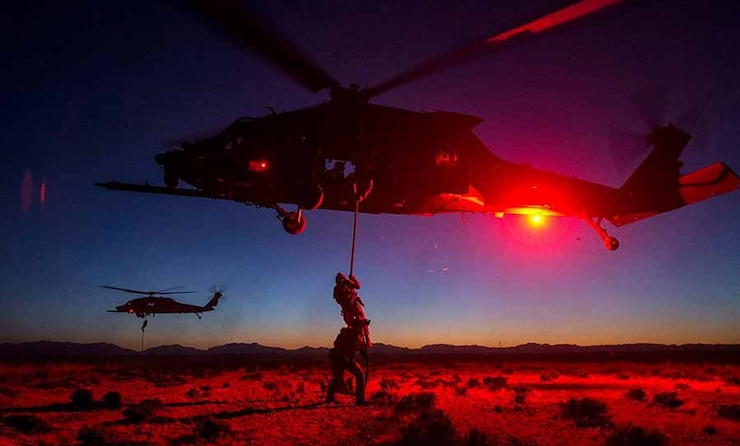 Image of Airmen and helicopters with link to Combat Camera