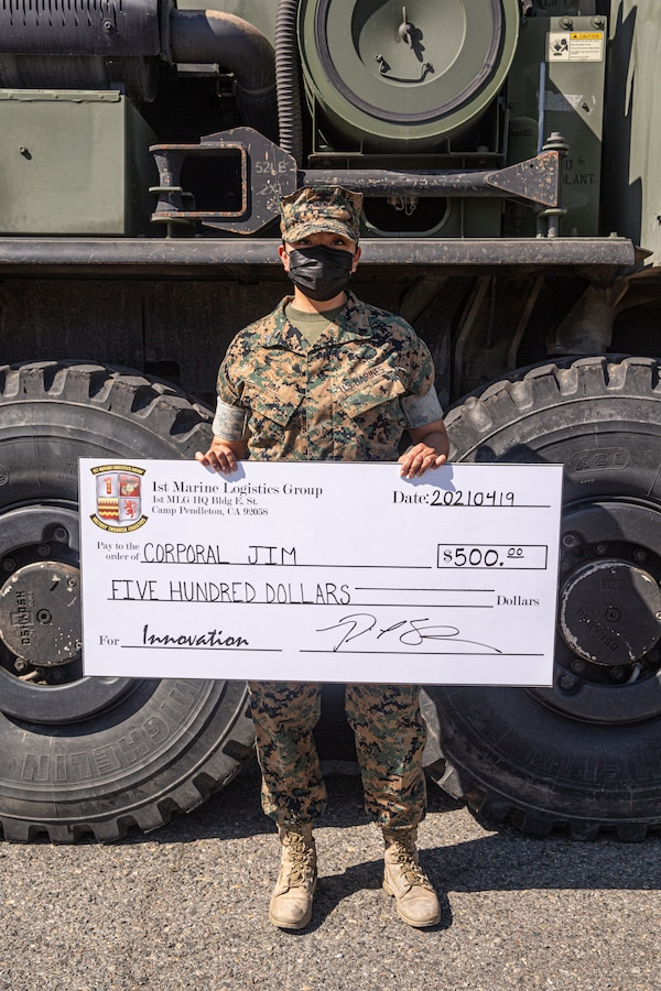 U.S. Marine Corps Cpl. Kudy L. Jim, a company clerk with Motor Transport Company A, 1st Transportation Battalion, Combat Logistics Regiment 1, 1st Marine Logistics Group, I Marine Expeditionary Force, was awarded a $500 check by Brig. Gen. Bobbi Shea, commanding general, 1st Marine Logistics Group, during a 1st MLG Innovation Awards Program ceremony on Marine Corps Base Camp Pendleton, California, Apr. 19, 2021. Jim received the check for significantly improving the process of battle tracking within a Combat Operations Center by developing a comprehensive system with built-in redundancy during Exercise Steel Knight 21.