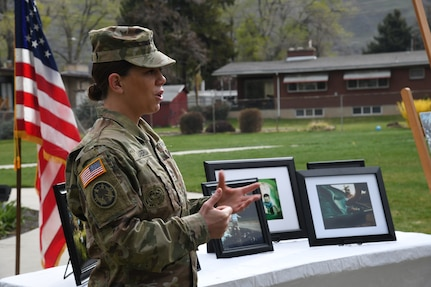 Soldier speaks at a park