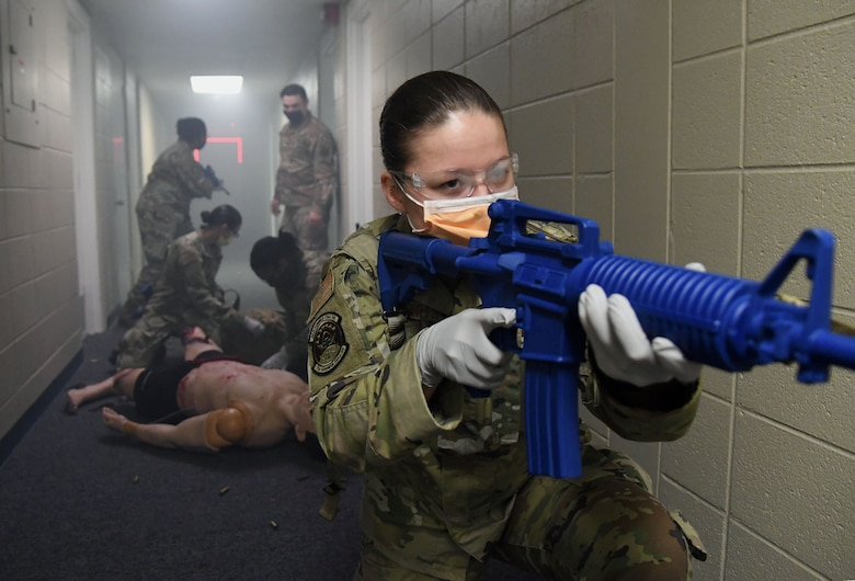 U.S. Air Force Airman 1st Class Andrea Roberts, 81st Medical Support Squadron medical technician, participates in the Tactical Combat Casualty Care training program inside the Locker House at Keesler Air Force Base, Mississippi, March 30, 2021. The training offers hands-on training in a simulated deployed environment using evidence based, life saving techniques and strategies to provide the best trauma care possible on the battlefield. (U.S. Air Force photo by Kemberly Groue)