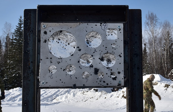 U.S. Air Force Airmen from 354th Civil Engineer Squadron Explosive Ordnance Disposal (EOD) Flight  inspect a gauge stand after a snow mitigation test March 18, 2021 at Eielson Air Force Base, Alaska.
