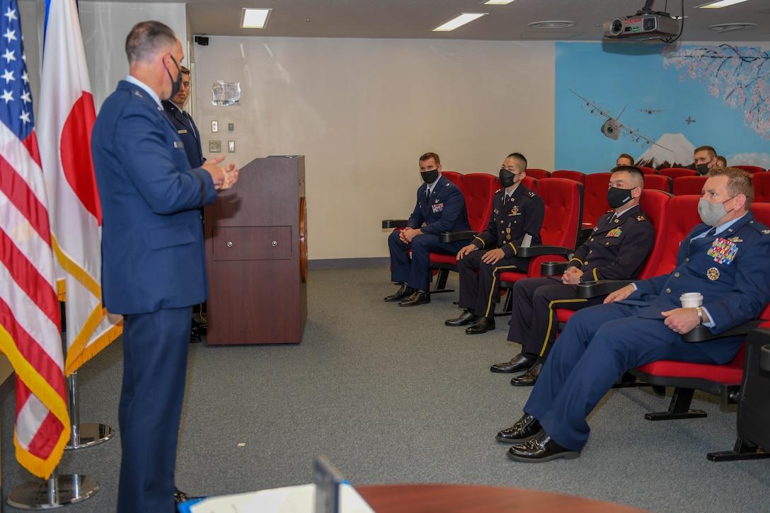 Brig. Gen. Leonard Kosinski gives remarks during an award ceremony praising Capt. Ryosuke Taki
