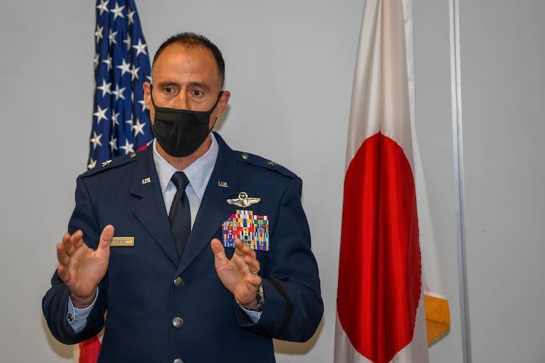 Brig. Gen. Leonard Kosinski speaks during an award ceremony recognizing Capt. Ryosuke Taki