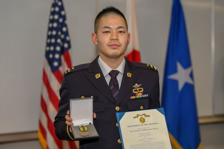 Capt. Ryosuke Taki poses with his Air Force Commendation Medal