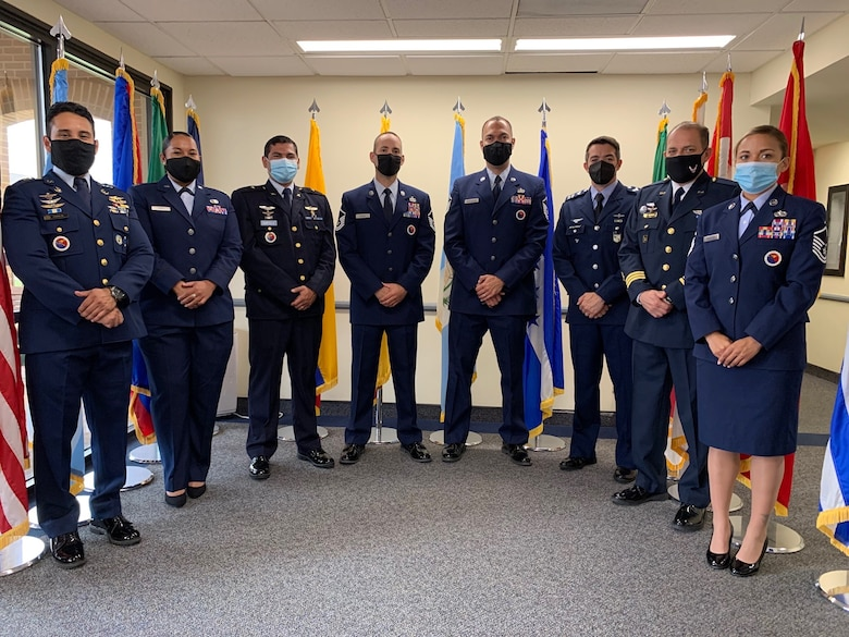 Professional Military Education Instructors pose for a photo March 30, 2021, at Joint Base San Antonio-Lackland, Texas, at the Inter-American Air Forces Academy after winning Outstanding EPME Center of the Year, Air Education and Training Command, in the 2020 Enlisted Professional Military Education Awards Program. Master Sgt. Diego Ladino and IAAFA's EPME Center are now competing for the awards at the Air Force level. (U.S. Air Force photo by Vanessa R. Adame)