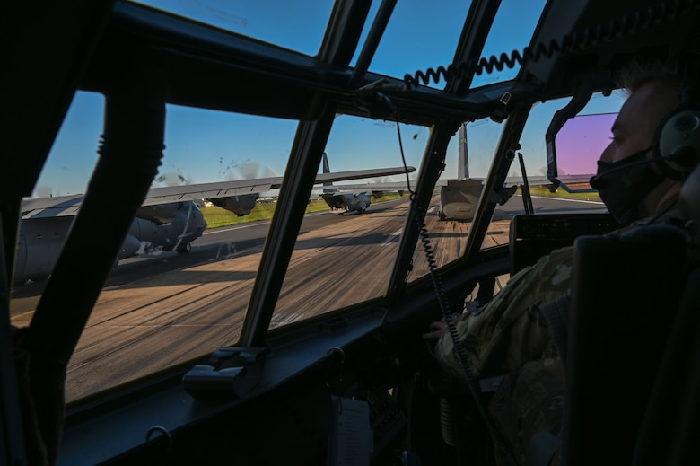 A pilot prepares for take off in a C-130J