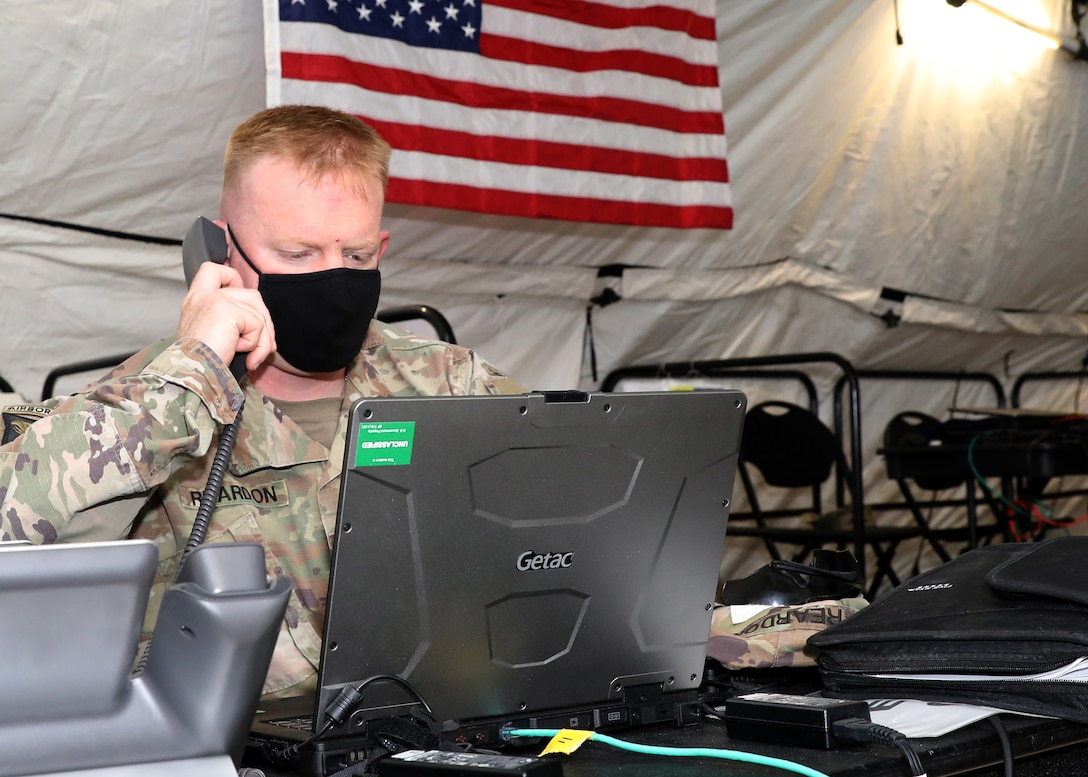 """Battle Major for 1st Theater Sustainment Command's expeditionary command post at Camp Arifjan, Kuwait, Maj. Howard Reardon, deployed to the camp for the Fort Knox, Kentucky, based 1st TSC's ECP validation exercise, seen here April 12, 2021 at the ECP's sustainment operations center. Reardon said, """"When you come here, you're in the thick of it. You're doing future operations, contingency operations to support the warfighter, which is 1st TSC's focus."""" (U.S. Army photo by Staff Sgt. Neil W. McCabe)"""