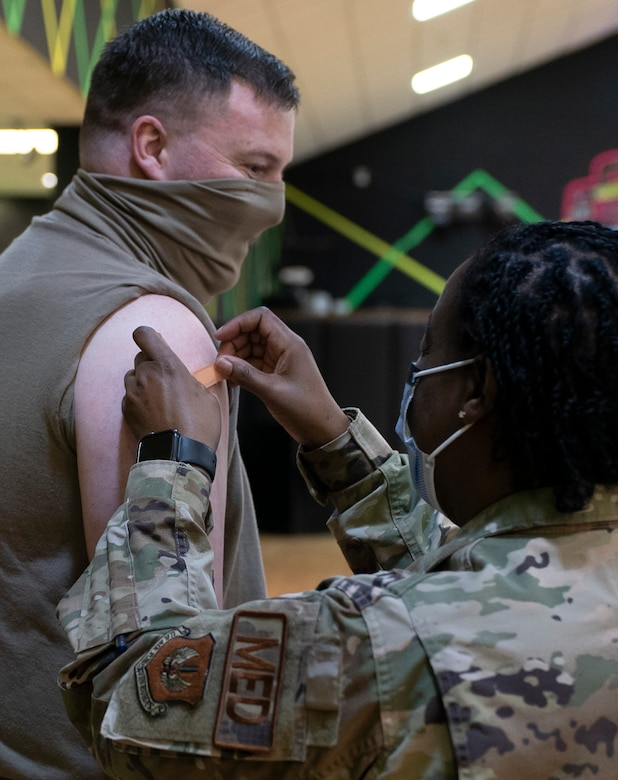 U.S. Air Force Tech. Sgt. Christopher Rex, 48th Contracting Squadron contract specialist, received the 10,000th COVID-19 vaccine to be administered by the 48th Medical Group at  Royal Air Force Lakenheath, England, April 16, 2021. Personnel were prioritized to receive the vaccine based on the guidance from the Centers for Disease Control and Prevention and on the DoD COVID Task Force's assessment of unique DoD mission requirements. (U.S. Air Force photo by Airman 1st Class Jessi Monte)