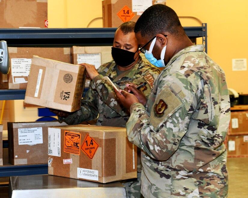 Men inspecting boxes