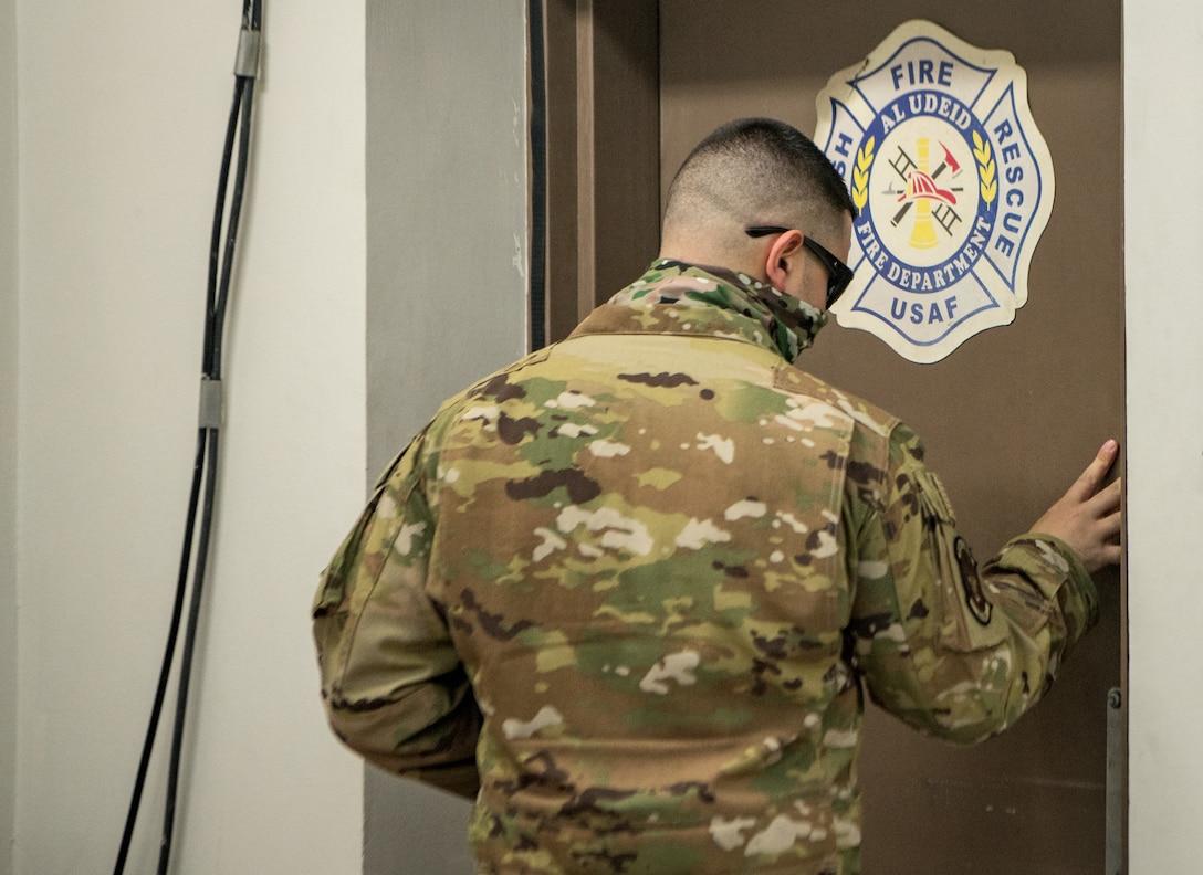 an airman exits a door