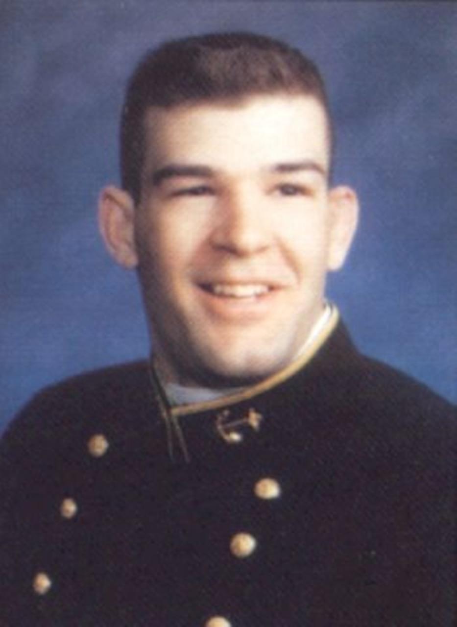 A U.S. Naval Academy cadet poses for a headshot photo.