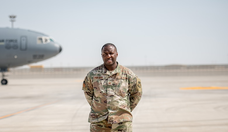 an airman poses for a portrait