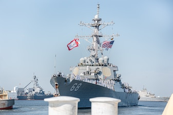 The Arleigh Burke-class guided-missile destroyer USS The Sullivans (DDG 68) departs from Mayport basin for deployment.