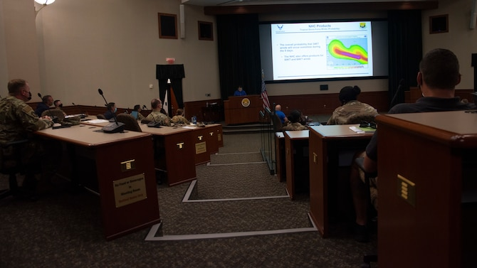 Personnel assigned to MacDill Air Force Base, Fla., attend a briefing during a joint force hurricane exercise, April 20, 2021.