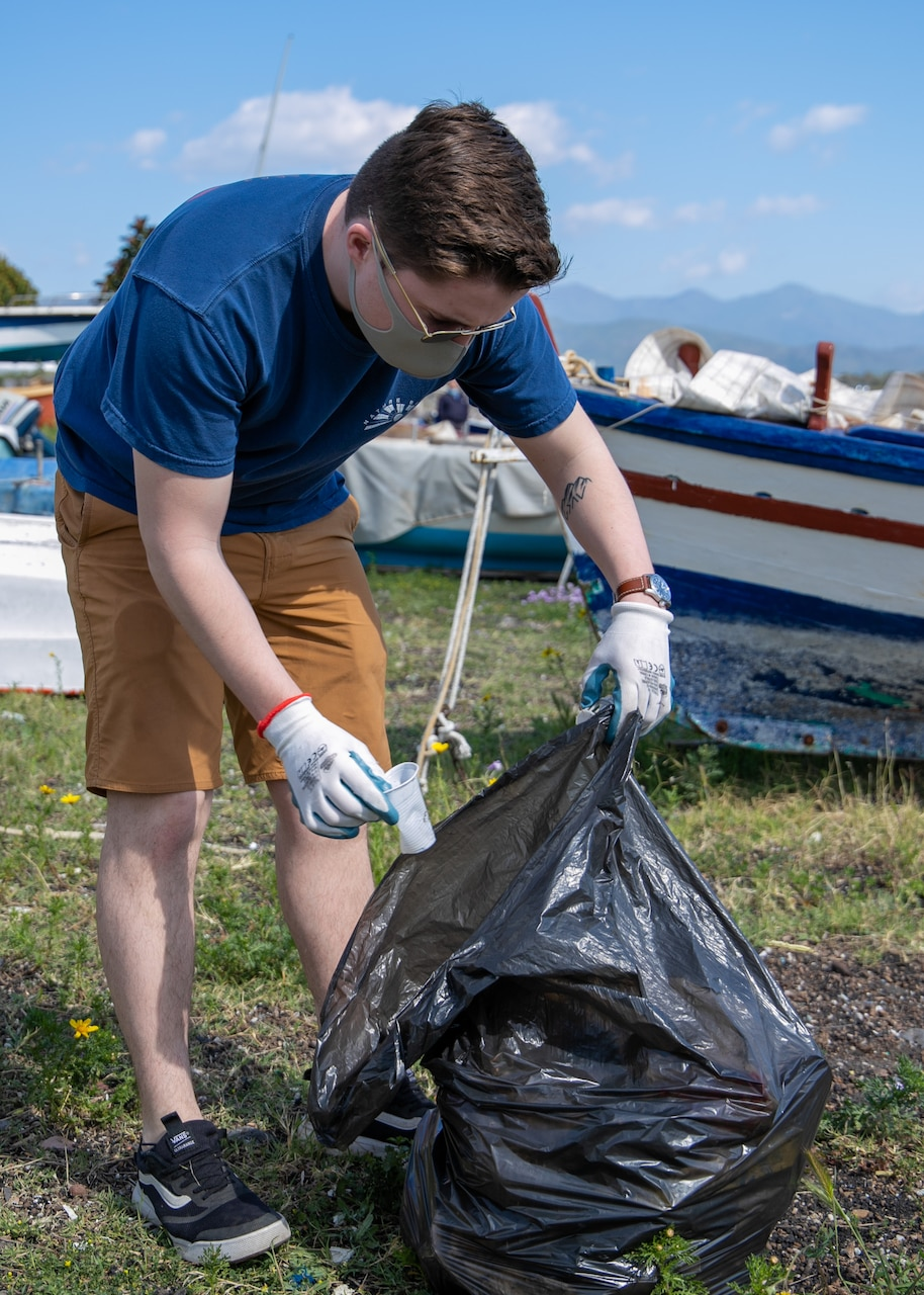 """210407-N-NO901-0002 SIGONELLA, Italy (April 7, 2021) """"Grey Knights"""" of Patrol Squadron (VP) 46 support an environmental initiative held at Three Rock Beach, near the town center of the coastal village of Riposto, April 7, 2021. VP-46 is currently forward deployed to the US Sixth Fleet area of operations and is assigned to Commander, Task Force 67, responsible for tactical control of deployed maritime patrol and reconnaissance squadrons throughout Europe and Africa. (U.S. Navy courtesy photo)"""