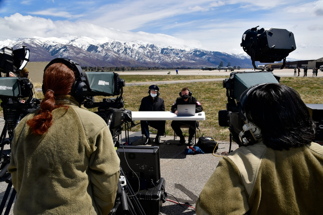 """Air Force Col. (Ret.) Gail Halvorsen (left center), the """"Berlin Candy Bomber,"""" is interviewed by Staff Sgt. Codie Trimble, F-35A Lightning II Demonstration Team public affairs, during a live stream of a demo team practice session April 16, 2021, at Hill Air Force Base, Utah. Halvorsen and family members witnessed the F-35 demo and then visited with the demo pilot and team afterward. (U.S. Air Force photo by Todd Cromar)"""