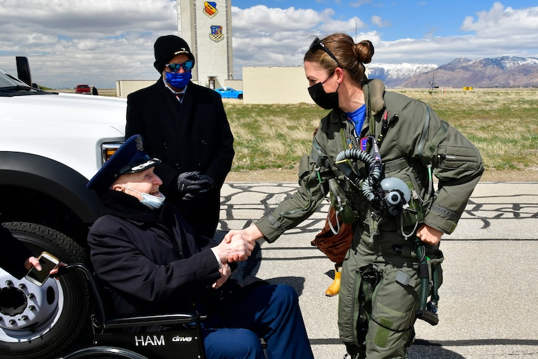 """Air Force Col. (Ret.) Gail Halvorsen, the """"Berlin Candy Bomber,"""" meets with Maj. Kristin """"BEO"""" Wolfe, F-35A Lightning II Demo Team pilot, after a demo team practice session April 16, 2021, at Hill Air Force Base, Utah. Halvorsen and family members witnessed the F-35 demo and then visited with the demo pilot and team afterward. (U.S. Air Force photo by Todd Cromar)"""