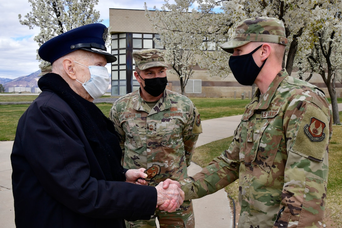 """Air Force Col. (Ret.) Gail Halvorsen (left), the """"Berlin Candy Bomber,"""" is greeted by Tech. Sgt. Daniel Sargent (right) and Chief Master Sgt. Andrew Slater, both with the 75th Logistics Readiness Squadron, April 16, 2021, during a visit to Hill Air Force Base, Utah. Sargent was the 2019 Col. Gail Halvorsen Outstanding Air Transportation Individual of the Year award recipient for Air Force Materiel Command. (U.S. Air Force photo by Todd Cromar)"""